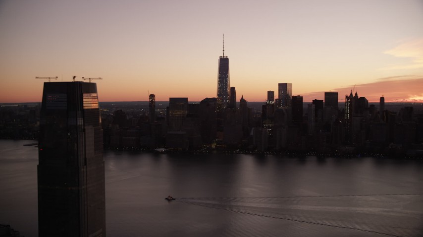 6K stock footage aerial video of World Trade Center skyline at sunrise in Lower Manhattan, New York City Aerial Stock Footage | AX118_021