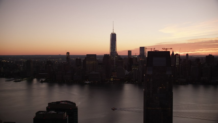 6K stock footage aerial video of World Trade Center skyline across the river at sunrise in Lower Manhattan, New York City Aerial Stock Footage | AX118_022