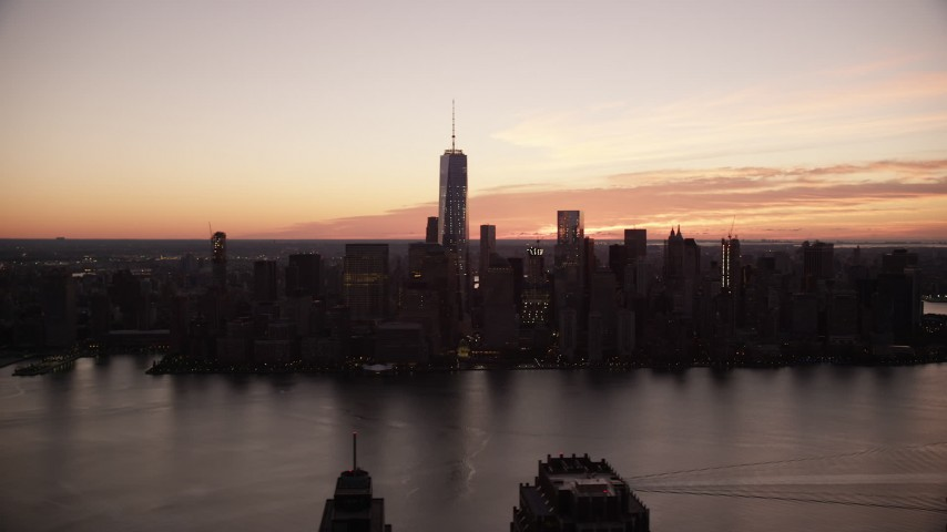 6K stock footage aerial video of the World Trade Center skyline at sunrise in Lower Manhattan, New York City Aerial Stock Footage | AX118_023