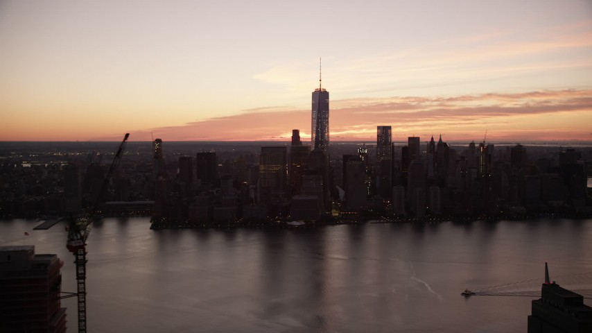 6K stock footage aerial video of a view of the World Trade Center skyline at sunrise in Lower Manhattan, New York City Aerial Stock Footage | AX118_024
