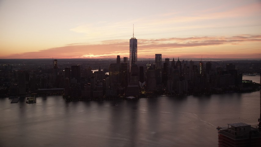 6K stock footage aerial video view across the river of World Trade Center skyline at sunrise in Lower Manhattan, New York City Aerial Stock Footage | AX118_025