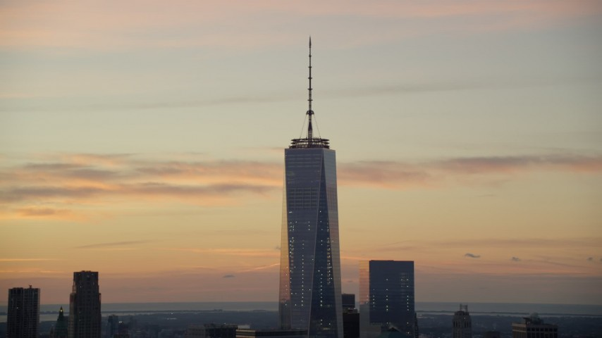 6K stock footage aerial video of tilt up One World Trade Center at sunrise in Lower Manhattan, New York City Aerial Stock Footage | AX118_027