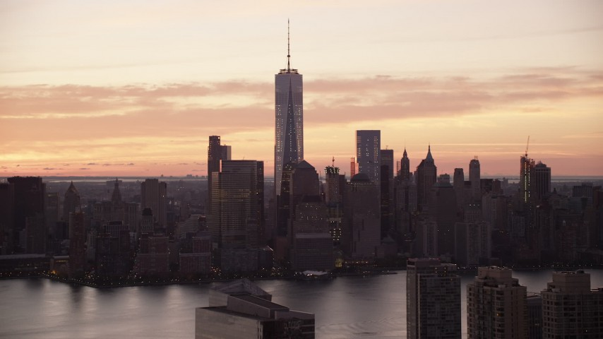6K stock footage aerial video of a view of the World Trade Center skyline at sunrise in Lower Manhattan, New York City Aerial Stock Footage | AX118_030