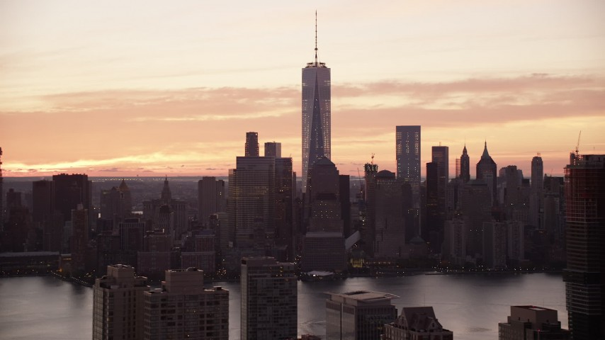 6K stock footage aerial video of the towering World Trade Center skyline at sunrise in Lower Manhattan, New York City Aerial Stock Footage AX118_031