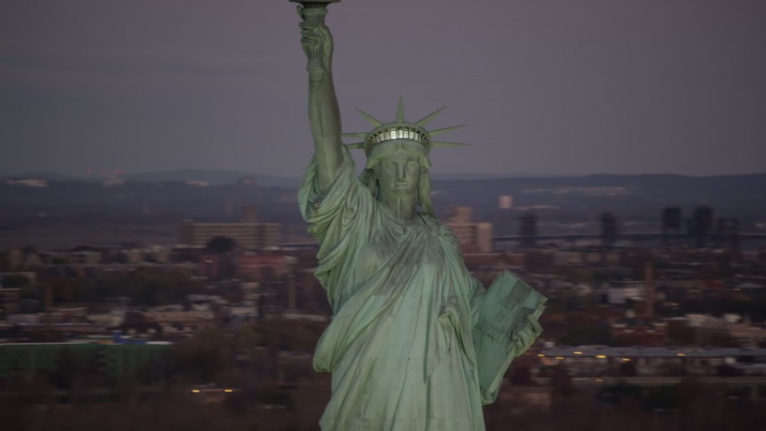 Statue of Liberty at Sunrise, New York Aerial Stock Footage   AX118_048