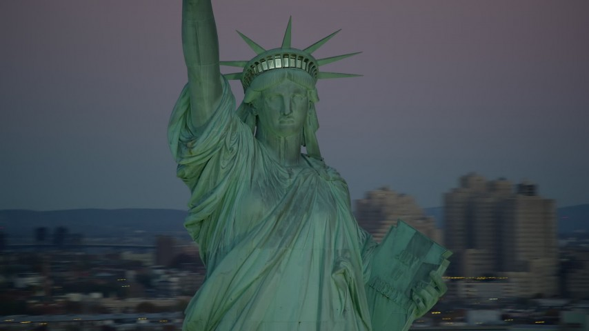 6K stock footage aerial video of orbiting the famous Statue of Liberty at sunrise, New York Aerial Stock Footage | AX118_058