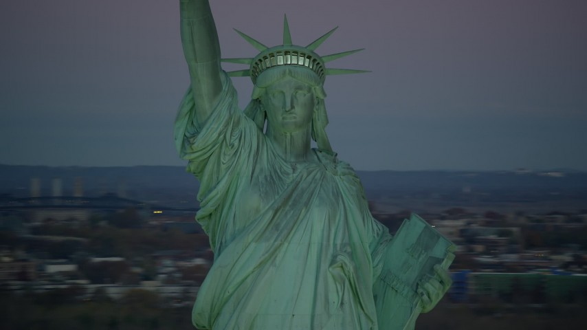 6K stock footage aerial video orbit the famous Statue of Liberty at sunrise, New York Aerial Stock Footage | AX118_059
