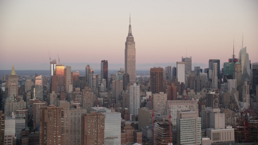 6K stock footage aerial video of Empire State Building at sunrise in Midtown Manhattan, New York City Aerial Stock Footage | AX118_062