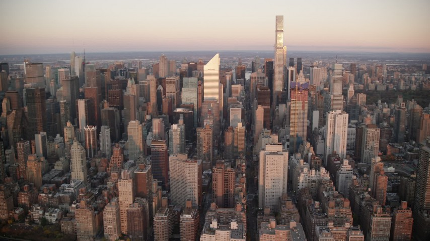 6K stock footage aerial video of skyscrapers at sunrise in Midtown Manhattan, New York City Aerial Stock Footage   AX118_066