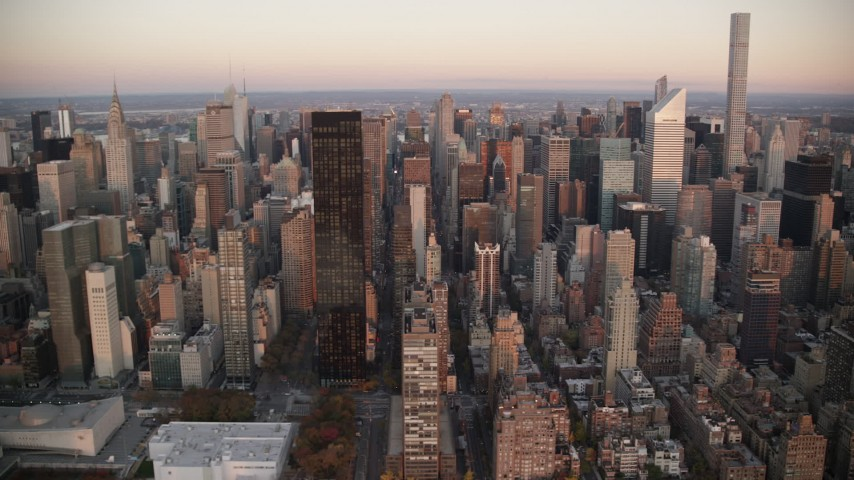 6K stock footage aerial video of tall skyscrapers at sunrise in Midtown Manhattan, New York City Aerial Stock Footage | AX118_067