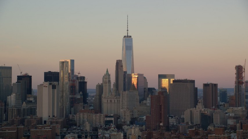 6K stock footage aerial video of Freedom Tower at sunrise in Lower Manhattan, New York City Aerial Stock Footage | AX118_070