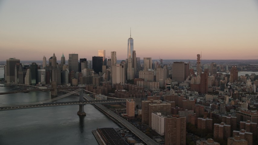 6K stock footage aerial video of a view of Lower Manhattan's skyscrapers at sunrise in New York City Aerial Stock Footage | AX118_071