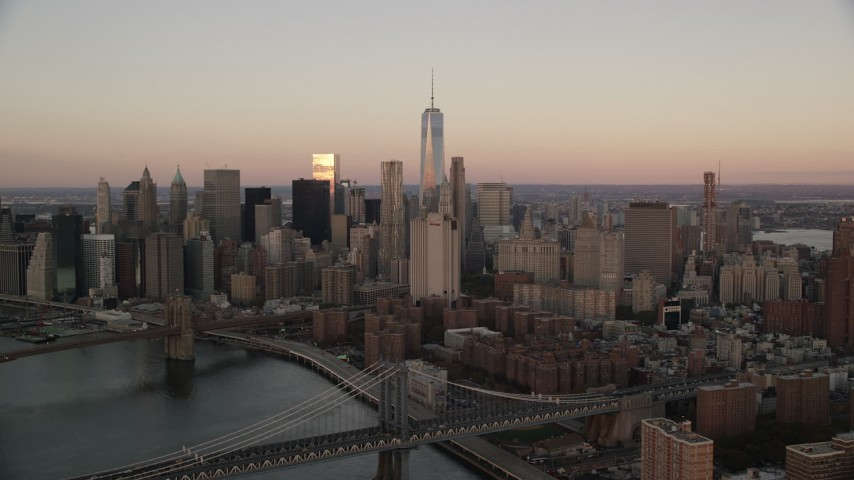 6K stock footage aerial video of Lower Manhattan giant skyscrapers at sunrise in New York City Aerial Stock Footage | AX118_072