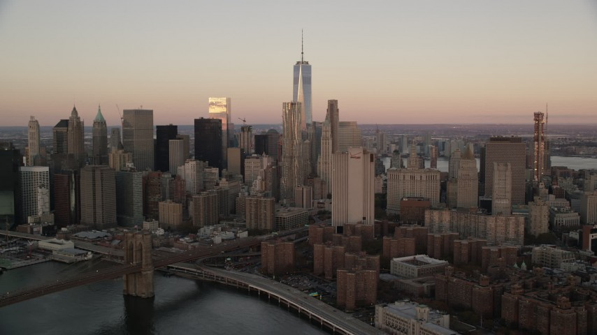 6K stock footage aerial video of Lower Manhattan's towering skyscrapers at sunrise in New York City Aerial Stock Footage | AX118_073
