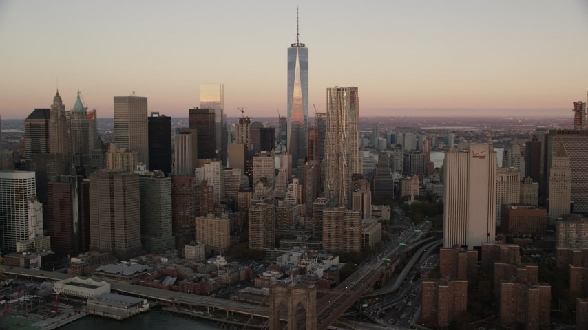 Lower Manhattan Skyscrapers at Sunrise in New York City Aerial Stock Footage | AX118_074