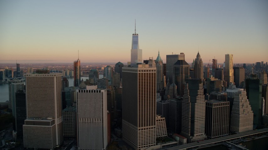 5.5K stock footage aerial video of flying by Lower Manhattan skyscrapers at sunrise in New York City Aerial Stock Footage   AX118_076E