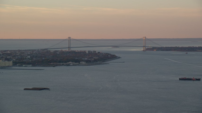 6K stock footage aerial video of a wide view of the Verrazano-Narrows Bridge, sunrise, New York City Aerial Stock Footage | AX118_080