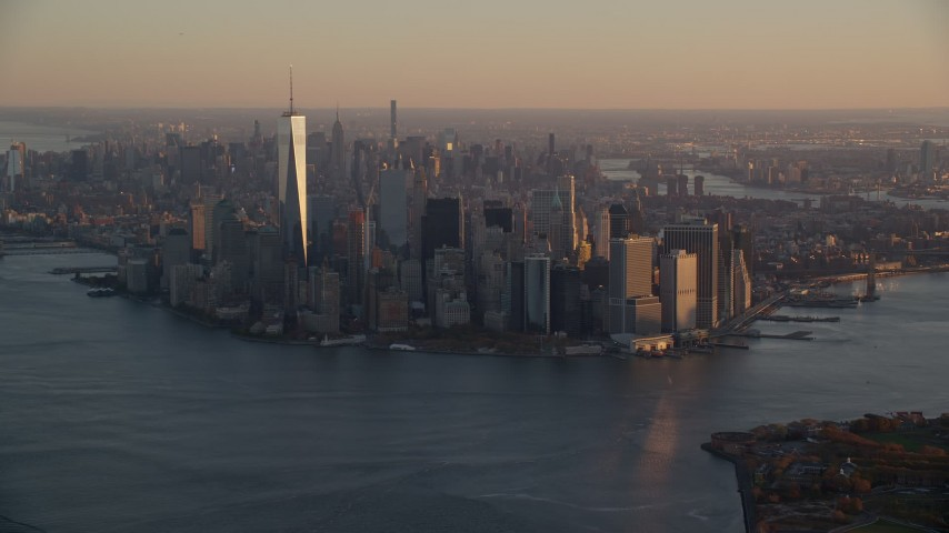 5.5K stock footage aerial video of a slow approach to Lower Manhattan at sunrise, New York City Aerial Stock Footage | AX118_083