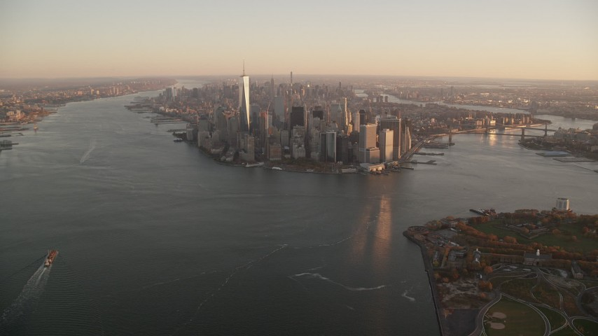 Lower Manhattan at Sunrise, New York City Aerial Stock Footage | AX118_084