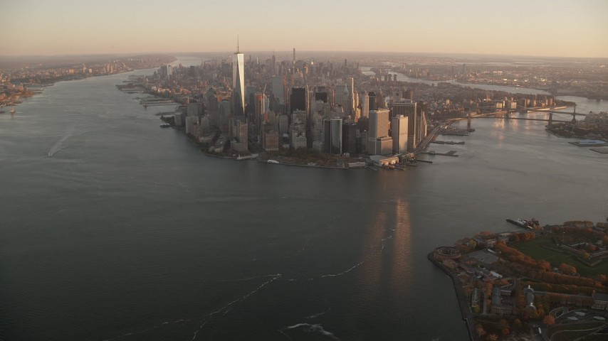 6K stock footage aerial video of a slow approach to skyscrapers in Lower Manhattan at sunrise, New York City Aerial Stock Footage | AX118_084