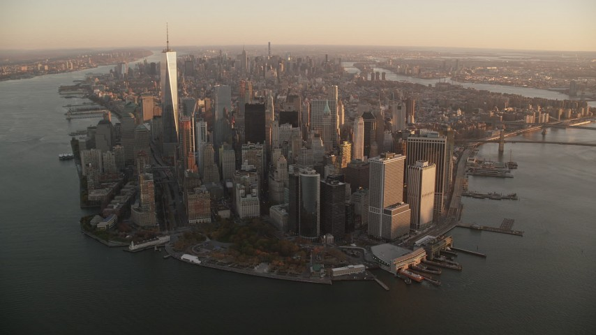 6K stock footage aerial video of flying toward Lower Manhattan at sunrise, New York City Aerial Stock Footage | AX118_086