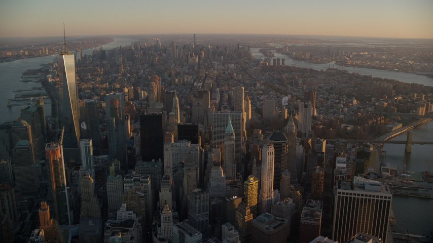 5.5K stock footage aerial video of Lower and Midtown Manhattan skyscrapers at sunrise, New York City Aerial Stock Footage | AX118_087E