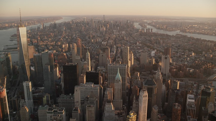 6K stock footage aerial video of flying over Lower Manhattan toward Midtown at sunrise, New York City Aerial Stock Footage | AX118_088
