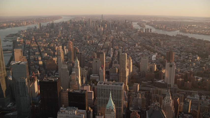6K stock footage aerial video of Midtown seen from Lower Manhattan at sunrise, New York City Aerial Stock Footage | AX118_089