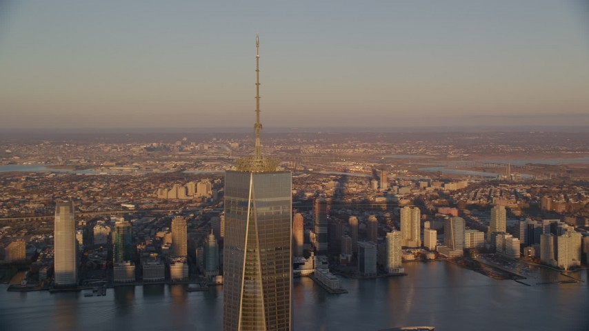 5.5K stock footage aerial video orbit the top of Freedom Tower at sunrise in Lower Manhattan, New York City Aerial Stock Footage | AX118_091