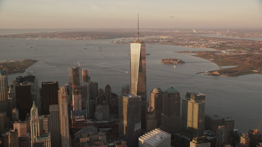 6K stock footage aerial video of gleaming Freedom Tower at sunrise in Lower Manhattan, New York City Aerial Stock Footage | AX118_094
