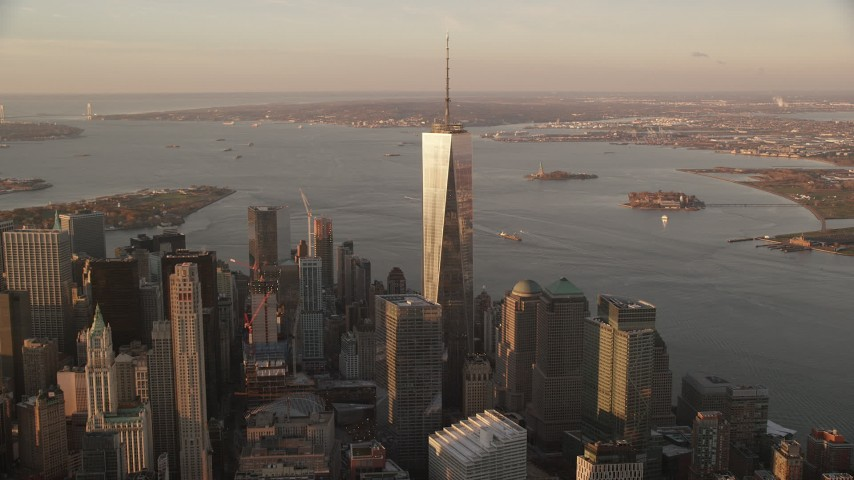 6K stock footage aerial video of an orbit of One World Trade Center at sunrise in Lower Manhattan, New York City Aerial Stock Footage | AX118_095