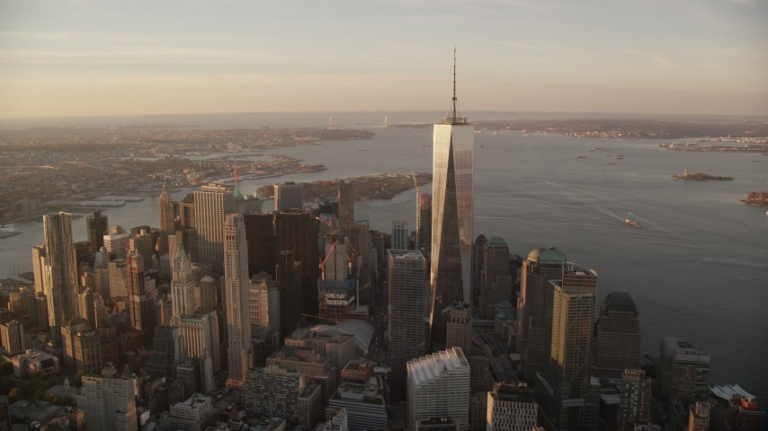 6K stock footage aerial video of a wide orbit of Freedom Tower at sunrise in Lower Manhattan, New York City Aerial Stock Footage AX118_096