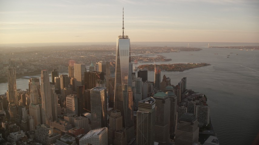 6K stock footage aerial video fly wide orbit around Freedom Tower at sunrise in Lower Manhattan, New York City Aerial Stock Footage | AX118_097