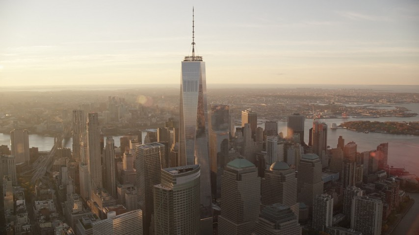 6K aerial video fly wide circle around Freedom Tower at sunrise in Lower Manhattan, New York City Aerial Stock Footage | AX118_098