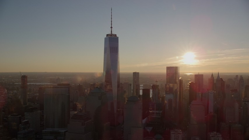 6K stock footage aerial video of orbiting around Freedom Tower with view of rising sun in Lower Manhattan, New York City Aerial Stock Footage AX118_099 | Axiom Images