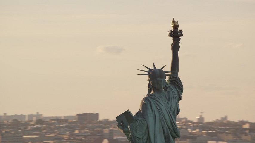 6K stock footage aerial video orbiting around the Statue of Liberty at sunrise in New York Aerial Stock Footage | AX118_112