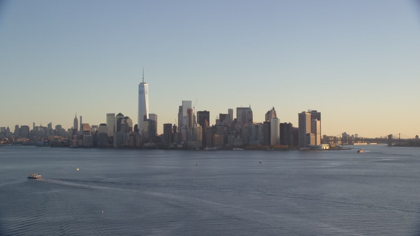 6K stock footage aerial video of the Lower Manhattan skyline at sunrise in New York Aerial Stock Footage | AX118_123