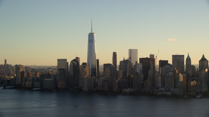 6K stock footage aerial video of approaching the Lower Manhattan skyline at sunrise in New York City Aerial Stock Footage | AX118_149