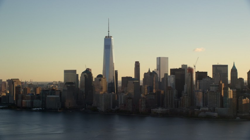 6K stock footage aerial video approach Freedom Tower and Lower Manhattan skyline at sunrise in New York City Aerial Stock Footage | AX118_150