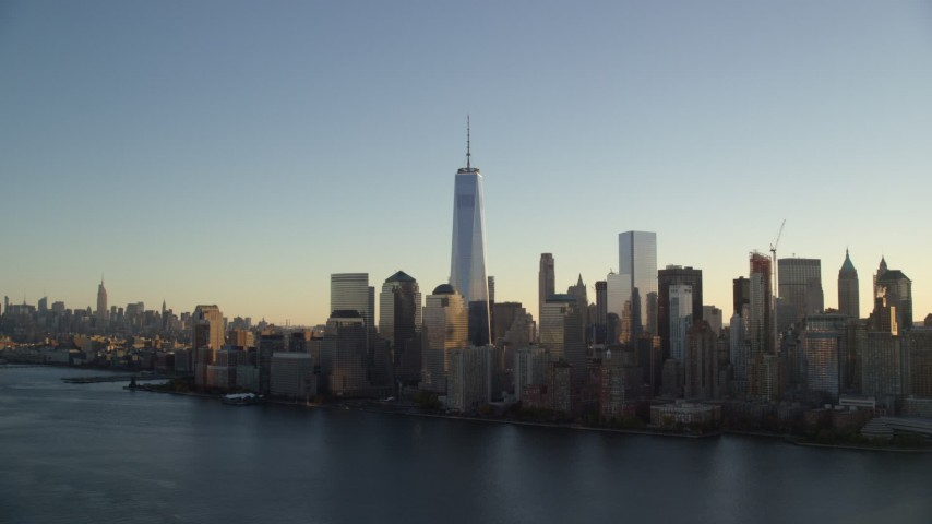 6K stock footage aerial video of approaching the World Trade Center skyline at sunrise in New York City Aerial Stock Footage | AX118_152