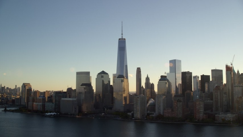 6K stock footage aerial video orbit the World Trade Center skyline at sunrise in New York City Aerial Stock Footage | AX118_153