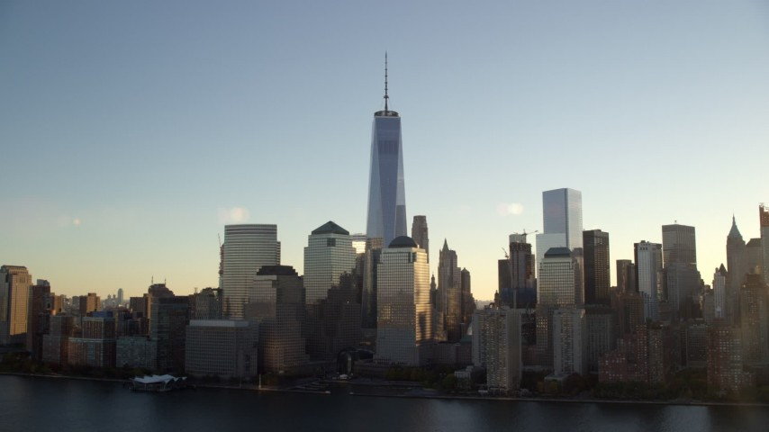 6K stock footage aerial video orbit Freedom Tower and World Trade Center skyline at sunrise in New York City Aerial Stock Footage | AX118_154