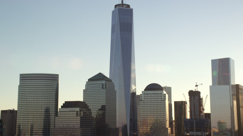 6K stock footage aerial video of the One World Trade Center skyscraper at sunrise in New York City Aerial Stock Footage   AX118_155
