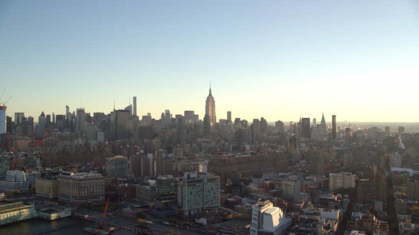 6K stock footage aerial video of a view of Midtown skyscrapers at sunrise in New York City Aerial Stock Footage | AX118_160