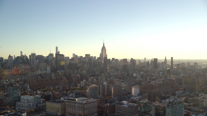 6K stock footage aerial video of the famous Empire State Building and Midtown skyscrapers at sunrise in New York City Aerial Stock Footage | AX118_161