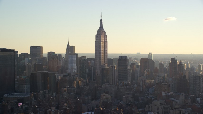6K stock footage aerial video of the Empire State Building at sunrise in Midtown, New York City Aerial Stock Footage   AX118_162