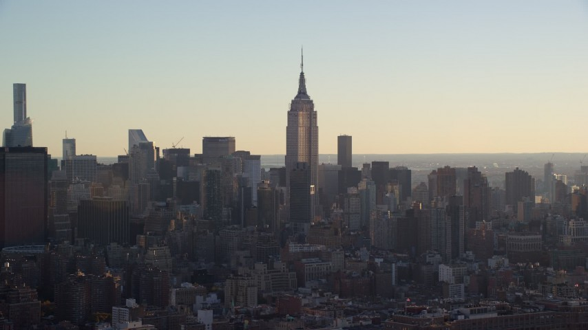 5.5K stock footage aerial video of a wide orbit of the Empire State Building in Midtown at sunrise, New York City Aerial Stock Footage | AX118_163E