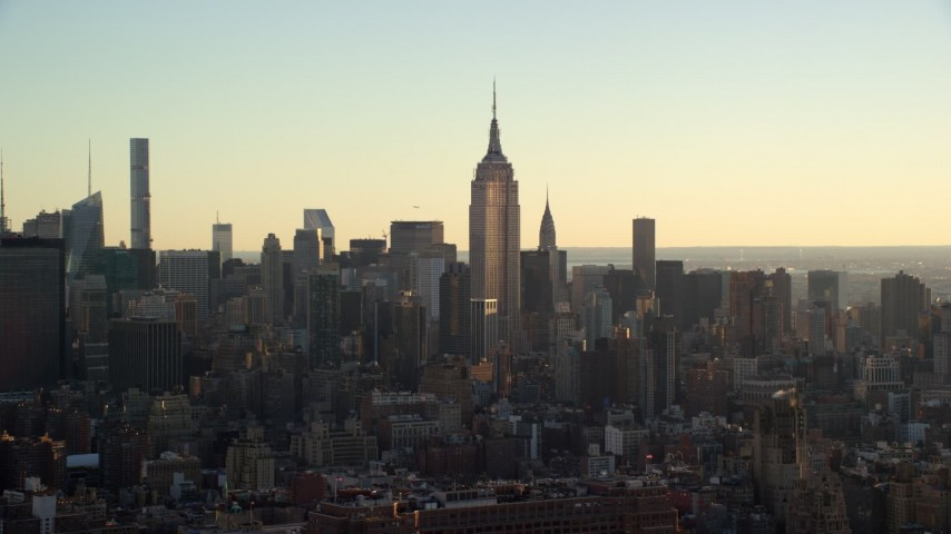 6K stock footage aerial video of an orbit of the Empire State Building at sunrise in Midtown, New York City Aerial Stock Footage | AX118_164