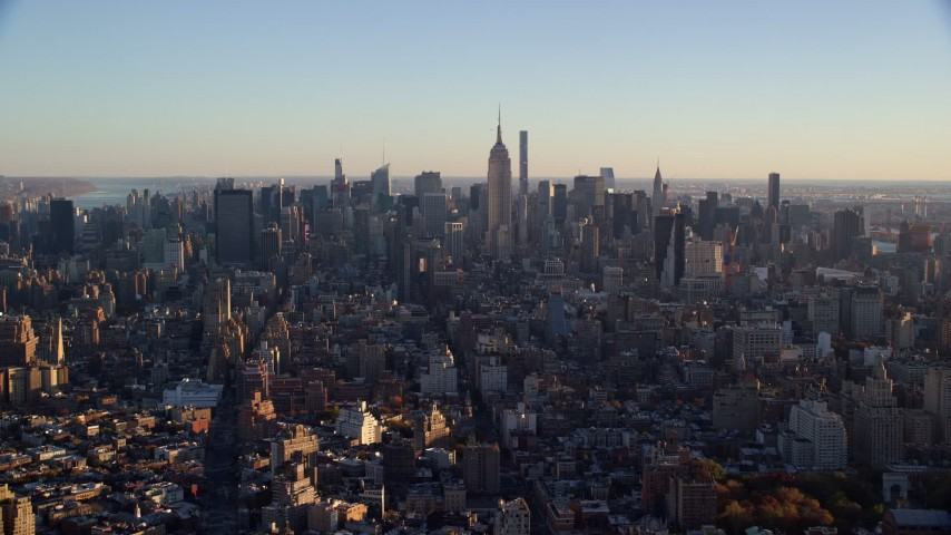 6K stock footage aerial video of a wide view of skyscrapers in Midtown Manhattan at sunrise in New York City Aerial Stock Footage | AX118_167