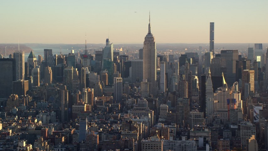 6K stock footage aerial video of historic Empire State Building and Midtown at sunrise in New York City Aerial Stock Footage | AX118_168